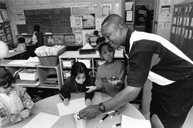 Black-teacher-in-classroom